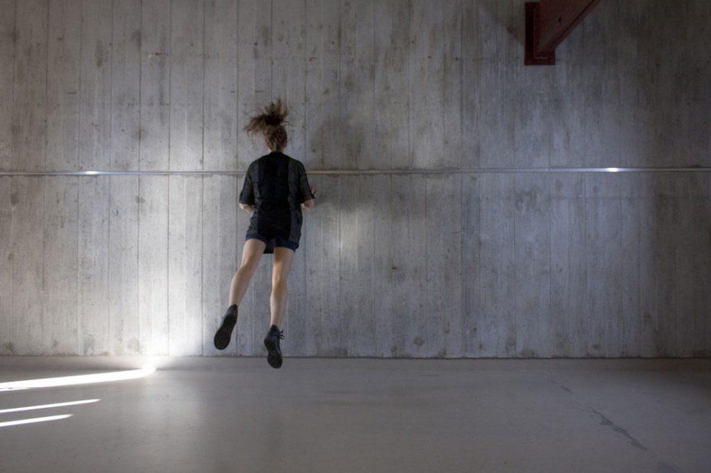 Movement-against-concrete-wall